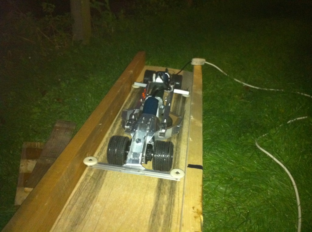 This photo was in the dark for a reason. After the crash in the first test run major repairs were needed. This photo showed the completed dragster after repairs at 3a.m. the night before we drove to the competition.